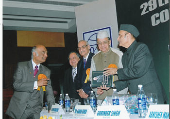 "Dr. Singh's text book ""Bhupendra Acupuncture Techniques"" being released by Dr. Karan Singh"